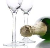 De flessen hoog zeer belangrijk licht van Champagne Stock Foto's