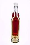 De flessen rood en namen wijn toe. royalty-vrije stock afbeelding