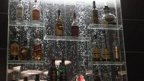 De flessen van alcoholmerken op bellenachtergrond Royalty-vrije Stock Foto's