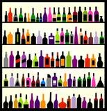 De flessen van de alcohol op de muur Stock Afbeeldingen