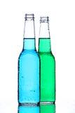 De flessen van de alcohol op wit stock afbeelding