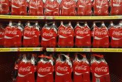 De flessen van de coca-cola Stock Foto