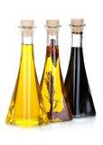 De Flessen van de Olijfolie en van de Azijn Stock Foto's
