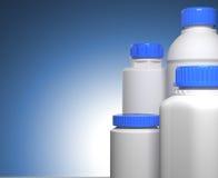 De Flessen van de pil op Blauwe Achtergrond. Stock Foto
