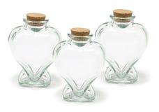 De Flessen van de Vorm van het hart Stock Foto