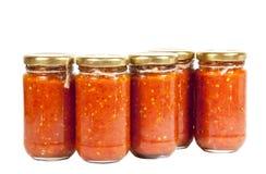 De flessen van Heldere Rode Spaanse pepers bewaren gekend als Mazavaroo Royalty-vrije Stock Foto