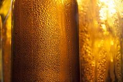 De flessen van het Backlightbier Stock Fotografie