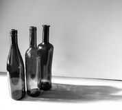 De flessen van het glas stock foto's