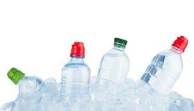 De flessen van het water stock fotografie