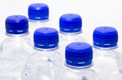 De flessen van het water Stock Afbeeldingen
