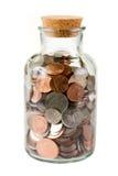De flessenhoogtepunt van het glas van muntstukken Stock Fotografie