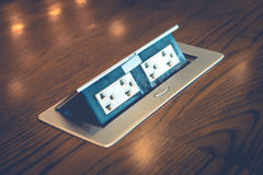 De focus of blur electric plug built in desk Royalty Free Stock Photography