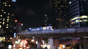 De-focus skytrain transportation in city urban lifestyle. At night stock video footage