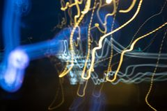 De focused/blur image Abstract background of night blue light and yellow on street , long exposure shot royalty free stock photos