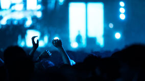 De-focused concert crowd. Hands up Royalty Free Stock Photography