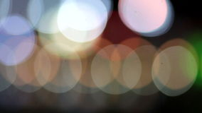De-fokuserad bakgrund för abstrakt begrepp för stadsnattbokeh arkivfilmer