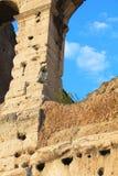 De forntida stenarna av Colosseumen (Rome) är inte ämnet som ska tajmas Arkivbild