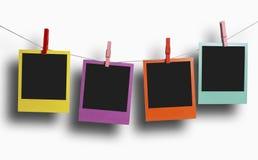 De foto's van kleurenpolaroid het hangen Stock Foto