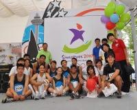 De foto van de groep tijdens het embleemlancering van de Olympische Spelen van de Jeugd Stock Afbeelding