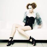 De foto van de manier van een jonge mooie redhead vrouw stock afbeelding