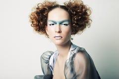 De foto van de manier van een jonge mooie redhead vrouw royalty-vrije stock afbeelding