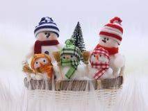De Foto van de voorraad: De Familie van de Sneeuwman van Kerstmis Royalty-vrije Stock Afbeelding