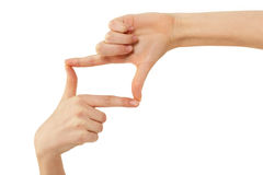 De fotoframe van de vinger het vrouwelijke handen gesturing Stock Fotografie