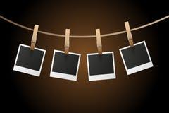 De frames van de foto op kabel Stock Fotografie