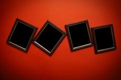 De frames van de kunst op rode muur Royalty-vrije Stock Foto's