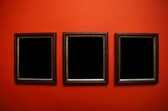 De frames van de kunst op rode muur Royalty-vrije Stock Foto
