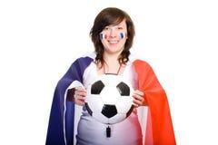 De Franse verdediger van het voetbalteam met vlag en bal stock afbeeldingen