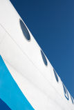 De fuselage van het vliegtuig met illuminators Stock Afbeelding