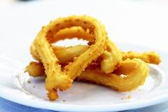 De gastronomische scène die van Churros ontbijt benadrukt stock foto's
