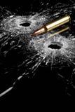De gaten van de kogel in glas Stock Afbeeldingen