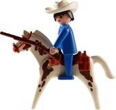 De geïsoleerde cowboy van het stuk speelgoed op paard Royalty-vrije Stock Foto