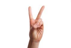 De geïsoleerde hand toont aantal twee Nummer twee concept stock afbeeldingen