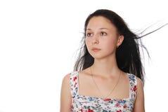 De geïsoleerde jonge vrouw die opzij kijkt Stock Fotografie
