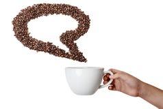 De geïsoleerde Kop en Koffie Bean Speech Bubble van de Handholding Royalty-vrije Stock Afbeelding