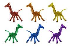 De geïsoleerde multicolored geparelde foto van het giraffenspeelgoed Stock Foto's