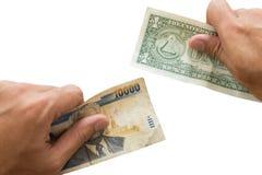 De geïsoleerde uitwisseling van geldmunten, Stock Foto's