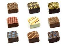 De geassorteerde verfraaide bonbons van de luxechocolade stock fotografie