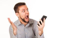 De gebaarde man spreekt op de telefoon Het stellen met verschillende emoties Simulatie van gesprek stock fotografie