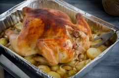 De gebakken folie van het de vorkbaksel van het kippenmes Stock Foto's