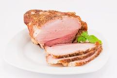 De gebakken varkensvlees en basilicumbladeren Royalty-vrije Stock Foto's