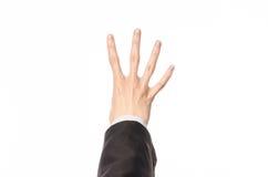 De gebaren en de Zaken als thema hebben: de zakenman toont handgebaren met een eerste-persoon in een zwart kostuum op een witte g Stock Afbeelding