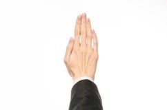 De gebaren en de Zaken als thema hebben: de zakenman toont handgebaren met een eerste-persoon in een zwart kostuum op een witte g Royalty-vrije Stock Afbeeldingen