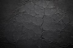 Donkere gebarsten gerimpelde textuur Stock Foto's
