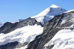 De gebieden van de sneeuw van Jungfrau in de Zwitserse Alpen Stock Foto