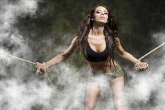 De gebonden vrouw in sexy stelt in militair Stock Afbeelding