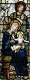 De Geboorte van Christus (geboorte van Jesus in gebrandschilderd glas) Stock Foto's